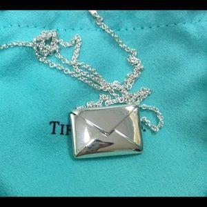 Tiffany&Co envelope pendant.